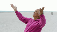 Senior African American woman on the beach Stock Footage