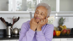 Senior African American woman with credit cards and money Stock Footage