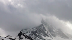 Thick grey clouds timelapse at Matterhorn Stock Footage