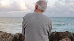 Portrait of senior Caucasian man at the beach Stock Footage