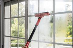 Cleaning window with steam Stock Photos