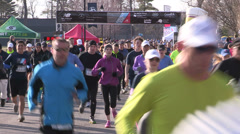 Runners in charity marathon and race event - stock footage