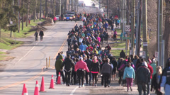 Runners in charity marathon and race event Stock Footage