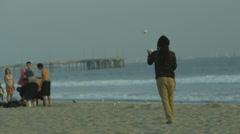Rasta Man Juggling Balls on Beach by Ocean in California in Slow Motion in 4K Stock Footage