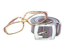 Male elegant belt and glasses isolated on the white Stock Photos