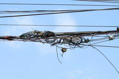 Tangled wires and telecommunication junction box Stock Photos