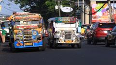 Jeepneys passing, Filipino inexpensive bus service. Legazpi, Philippines. Stock Footage