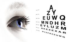 Eye with test vision chart close up Stock Illustration
