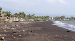 Black volcanic sand and waves on the polluted beach. Legazpi, Philippines Stock Footage