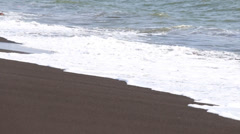Black volcanic sand and sea water waves on the beach. Legazpi, Philippines Stock Footage