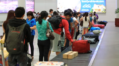 Passengers at baggage reclaim in airport Manila, Philippines. Stock Footage