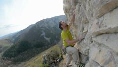 Romanian climber Mihnea Prundean climbing route in Turzii Gorge Romania close up Stock Footage
