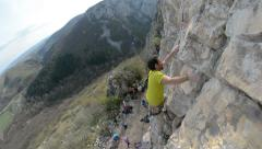 Romanian climber Mihnea Prundean climbing crack route in Turzii Gorge Romania Stock Footage