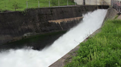 Open dam discharged a large amount of water,close up, tracking shot, pan left. Stock Footage