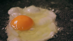 Egg cooks on frying pan Stock Footage