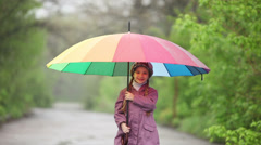 Portrait of a child with an umbrella in the park. Child waving hand Stock Footage