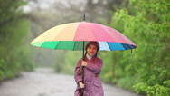 Stock Video Footage of Portrait of a child with an umbrella in the park. Child waving hand