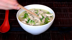 Man eats Vietnamese soup pho Stock Footage