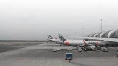 Planes waiting at the gates of the new Bangkok airport terminal. Stock Footage