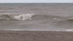 Intense waves rolling in and breaking during storm with hurricane force winds Stock Footage