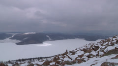 Lake Sut-Khol in winter viewed from hill. Tuva, Syberia, Russia Stock Footage
