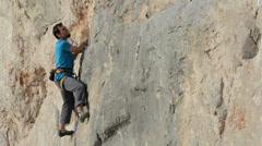 Mihnea rock climbing handheld Stock Footage