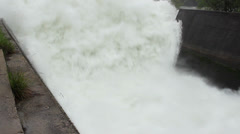Open dam discharged a large amount of water,rushing through the channel Stock Footage