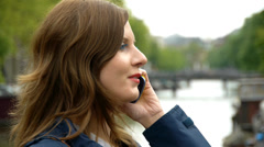 HD1080p50 Woman talking on cell phone in the City, Young People. - stock footage