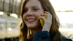 HD1080p50 Young Woman Talking On Cellphone On Train Station. Part 3. - stock footage