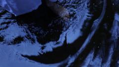 Woman in nightdress walks through stream in rain Stock Footage