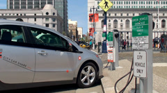 Plug-in hybrid electric vehicle is recharging at EV charging station. - stock footage