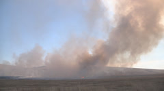 Wide shot of a smoke from burning field in Khakassia, Russia Stock Footage