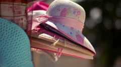 Summer hat . Closeup of straw hat. Few beach hats. Pretty straw hat with ribbon Stock Footage
