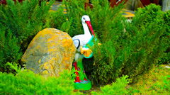 Stork with baby hiding in the branches of trees Stock Footage