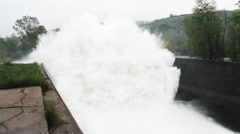 Open dam discharged a large amount of water from lake reservoir, stream, jets. - stock footage