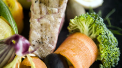 Avariety of fresh and blanched seasonal vegetables with grilled tuna,quaill egg - stock footage
