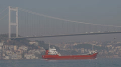 Bosphorus bridge and ship passing Stock Footage