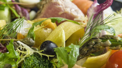 A variety of fresh and blanched seasonal vegetables with grilled tuna,quaill egg - stock footage