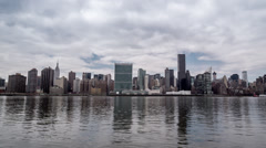 Manhattan Skyline in NYC across East River with Empire State Building in 4K Stock Footage