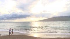 Lovers Walk Maui Beach at Sunset Stock Footage