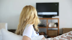 blond woman at home watching tv - stock footage