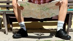 Tourist on a bench with the map Stock Footage