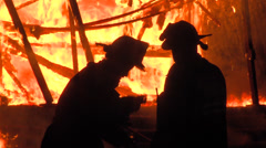 Female and Male firefighter Stock Footage