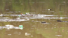 Ecological disaster, large amount of garbage in the lake after storm. Stock Footage