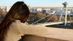 Woman do watch on SNP bridge Stock Footage