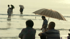 People on the beach in Sanya, China  Stock Footage