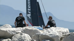 Athletes looking at America's cup boat  Stock Footage