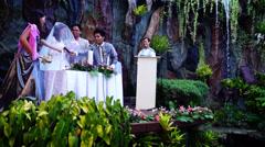 Bride says her vows at garden wedding Stock Footage