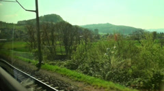 Travelling by train through beautiful swiss landscape Stock Footage