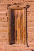 Vintage wooden door of aged american western home. log building. Stock Photos